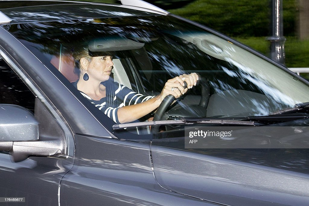 Dutch Queen Maxima drives a car as she arrives at the Royal Palace Huis ten Bosch in The Hague, on August 13, 2013. Dutch Prince Friso is to be buried near his mother's castle on Friday, days after he died from injuries sustained in a 2012 skiing accident, the palace said. King Willem-Alexander's brother Friso died on August 12, 2013, aged 44, around 18 months after after he was left brain-damaged and comatose by an avalanche while skiing in Austria. AFP PHOTO/ANP/Evert-Jan Daniels -NETHERLANDS