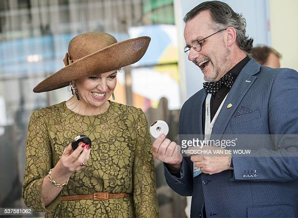 Dutch Queen Maxima looks at eHealth medical technology devices from company Scanadu with Lucien Engelen head of the REshape Innovation Center at the...