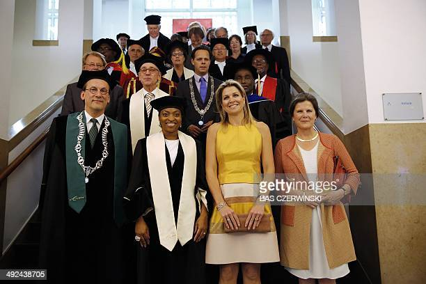 Dutch Queen Maxima poses beside Nigerian Prince Claus chairholder Jumoke Oduwole at the Institute of Social Studies as they attend a speech by Jumoke...