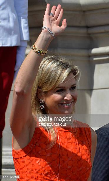 Dutch Queen Maxima waves while leaving the presidential palace following a meeting with President Ollanta Humala in Lima on March 7 2014 AFP PHOTO /...