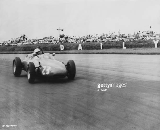 Dutch racing driver Carel Godin de Beaufort driving his Porsche during the Grand Prix circa 1960