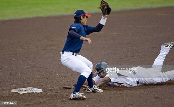 Dutch Raily Legito steals second base as Ryosuke Katsumi of Japan runs during the World Port Honkbal Tournament 2009 in Rotterdam July 9 2009 ANP ED...