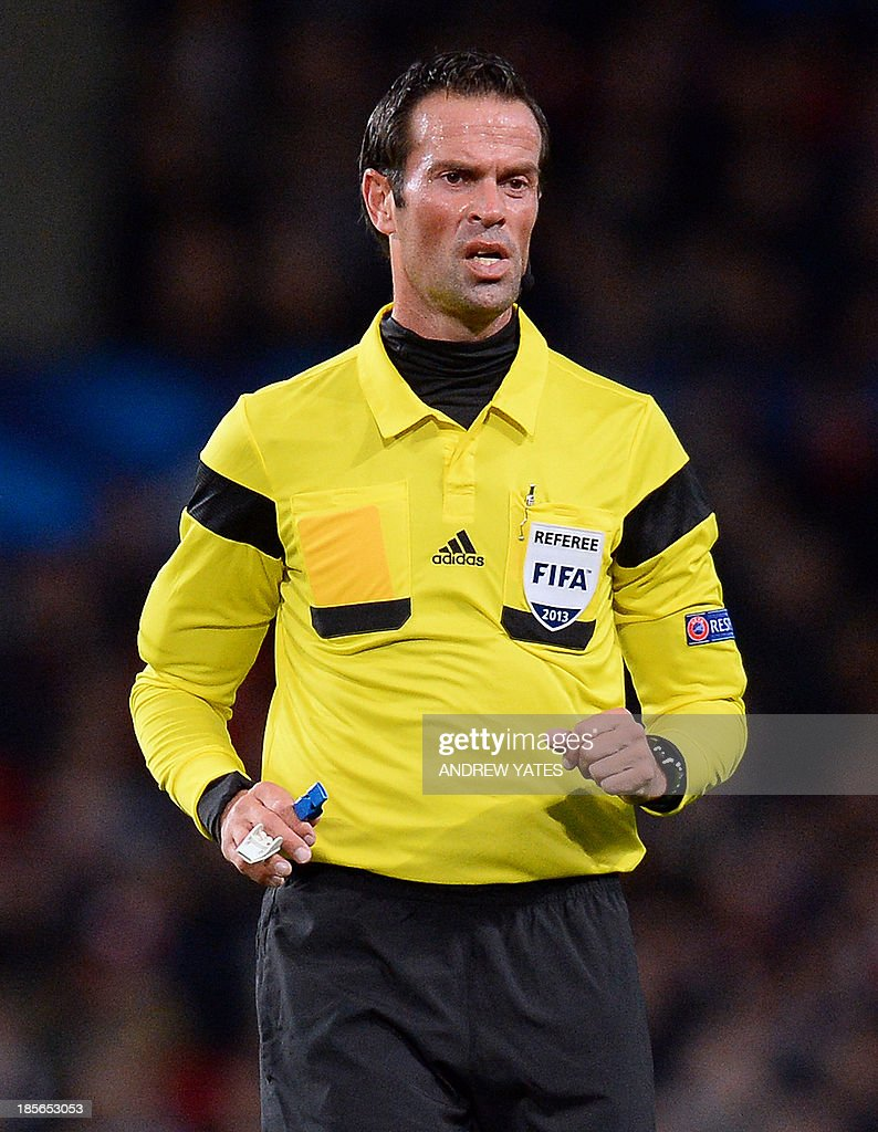 Dutch referee Bas Nijhuis is seen during the UEFA Champions League football match between Manchester United and Real Sociedad at Old Trafford in Manchester, north west England on October 23, 2013. AFP PHOTO/ANDREW YATES