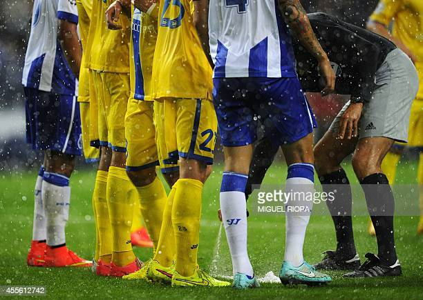 Dutch referee Bas Nijhuis marks a line on the ground before a freekick during the UEFA Champions League football match FC Porto vs FC BATE Borisov at...