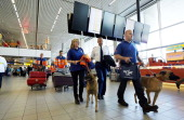 Dutch rescuers and rescue dogs arrive at Schiphol Airport in Amsterdam on May 25 before their departure to Panama A team of 18 rescuers and 12 rescue...