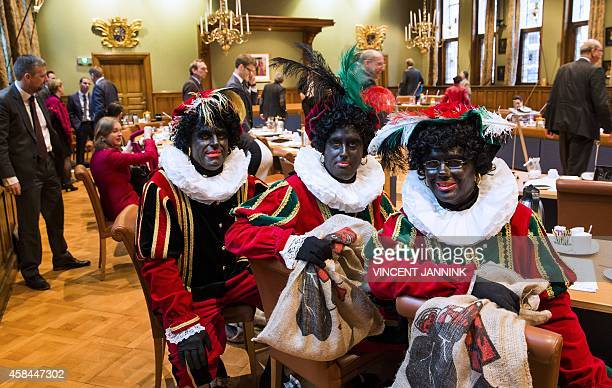 Dutch right wing PVV State members Ton van Kesteren Matthijs Jansen and Dennis Ram dressed as Black Pete the jolly sidekick of the Dutch Saint...