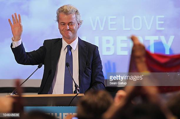 Dutch rightwing politician Geert Wilders greets supporters upon his arrival on October 2 2010 in Berlin Germany Wilders came on the invitation of...