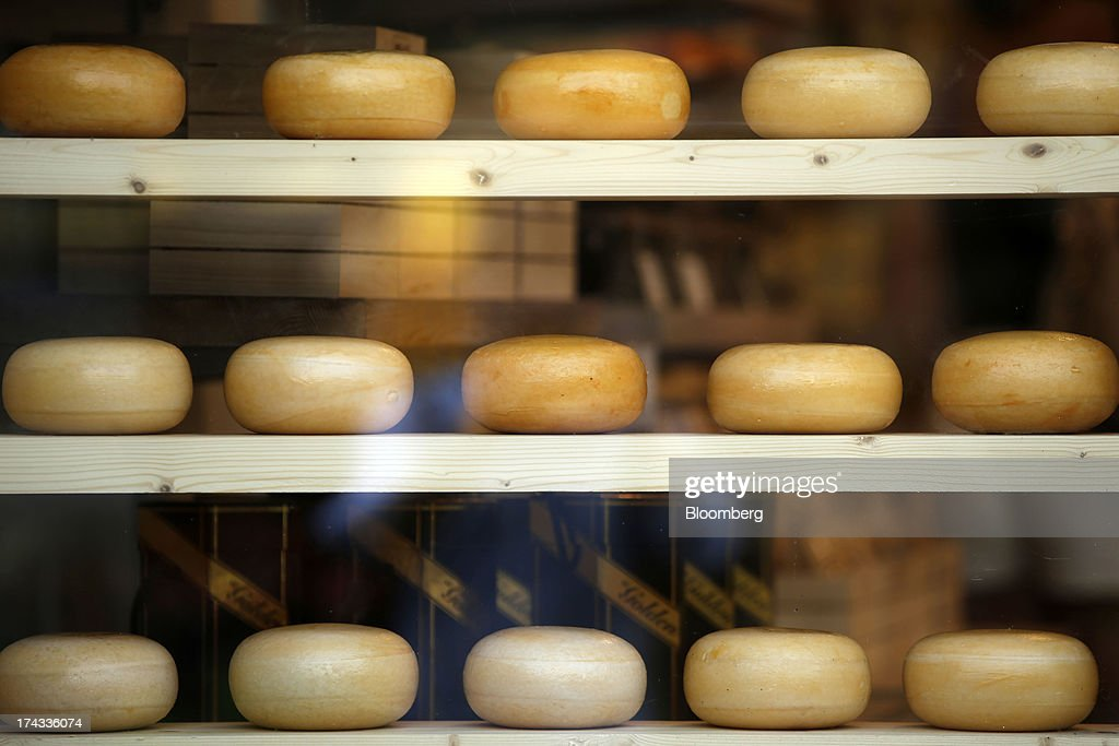 Dutch round cheeses sit in the window of a store in Amsterdam, Netherlands, on Tuesday, July 23, 2013. Dutch pension funds will be allowed to calculate liabilities on the basis of an adjusted discount rate as the government seeks to keep the retirement system viable amid low interest rates and an aging population. Photographer: Matthew Lloyd/Bloomberg via Getty Images