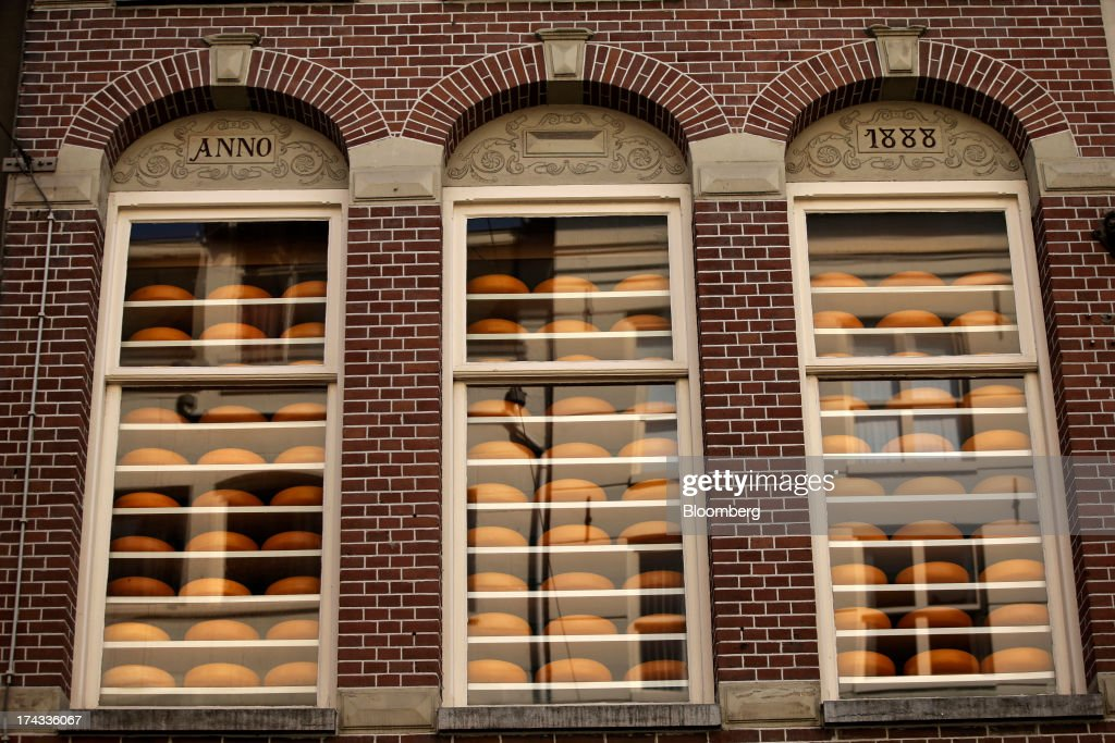 Dutch round cheeses sit in the windows of a store in Amsterdam, Netherlands, on Tuesday, July 23, 2013. Dutch pension funds will be allowed to calculate liabilities on the basis of an adjusted discount rate as the government seeks to keep the retirement system viable amid low interest rates and an aging population. Photographer: Matthew Lloyd/Bloomberg via Getty Images