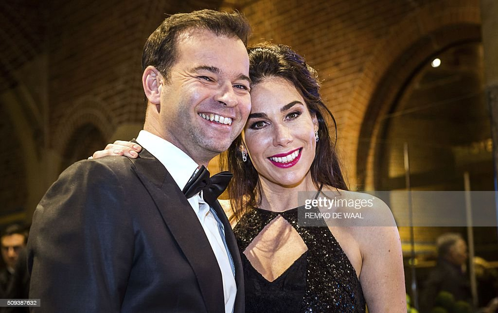 Dutch royalty watcher Peter van der Vorst and Dutch actress Halina Reijn arrive at the Beurs van Berlage in Amsterdam, to attend the first edition of the Dutch Correspondent's Dinner initiated by famous Dutch TV presenter Twan Huys, where Dutch Prime Minister Mark Rutte will deliver a speech, on February 10, 2016. / AFP / ANP / REMKO DE WAAL / Netherlands OUT