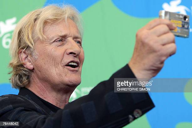 Dutch Rutger Hauer takes pictures of photographers as he poses during a photocall for the movie out of competition 'Blade Runner The final cut'...