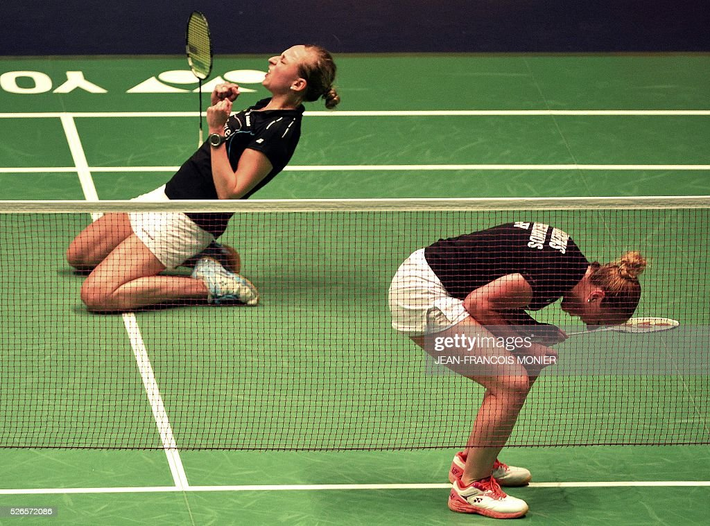 Dutch Selena Piek (L) and teammate Lefje Muskens (R) react after winning against Denmark players Maiken Fruergaard and Sara Thygesen during the 2016 European Badminton Championships Women's double semi-final match between Denmark and Netherlands, on April 30, 2016 in Mouilleron-le-Captif, western France. / AFP / JEAN