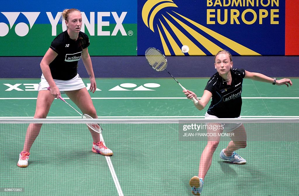 Dutch Selena Piek (R), flanked by teammate Lefje Muskens (L) hits a return against Denmark players Maiken Fruergaard and Sara Thygesen during the 2016 European Badminton Championships Women's double semi-final match between Denmark and Netherlands, on April 30, 2016 in Mouilleron-le-Captif, western France. / AFP / JEAN