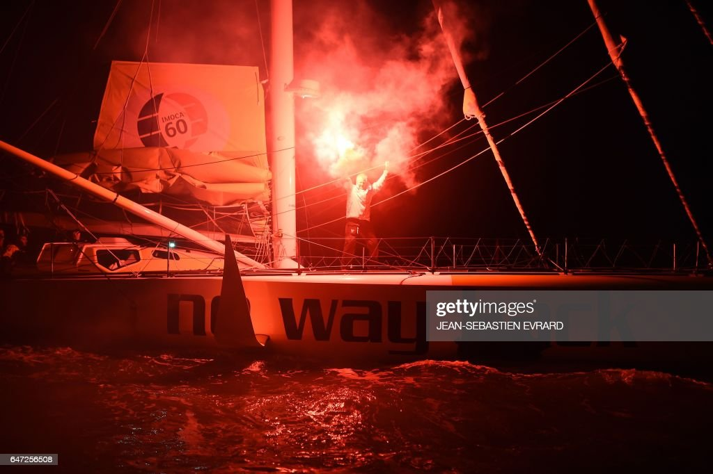Dutch skipper Pieter Heerema, placing 17th in the Vendee Globe around-the-world solo sailing race, celebrates aboard of his Imoca 60 monohull 'No Way Back' on March 2, 2017 as he arrives in Les Sables-d'Olonne, western France. /