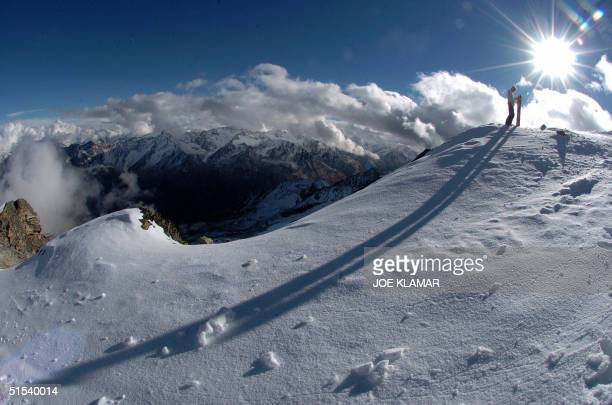 Dutch snowboarder enjoys a panorama of the Austrian Alps as he prepares for his ride from the 3340 metres high Schwarze Schneid mountain at the...