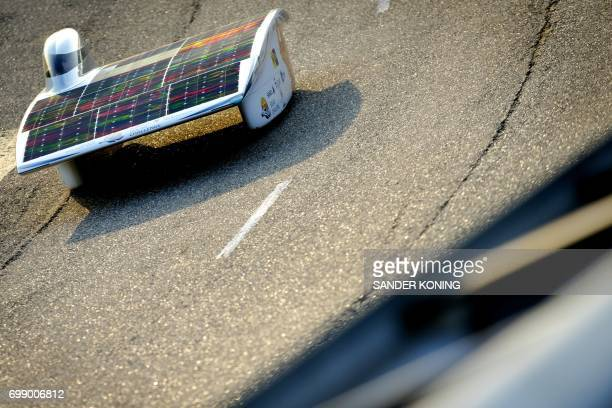 Dutch solarpowered car Nuna 8 takes the start of a twelvehourrace on a testtrack in Lelystad on June 21 2017 in an attempt to beat the world record...