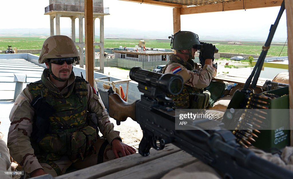 Dutch soldiers guard a check point at a police training center in Ali Abad district in Kunduz province on April 7, 2013. The Dutch have 500 soldiers which are part of International Security Assistance Force (ISAF) in Afghanistan. AFP PHOTO / Massoud HOSSAINI