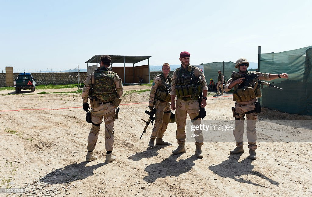 Dutch soldiers look on at a police training camp in Ali Abad district of Kunduz province on April 7, 2013. The Dutch have 500 soldiers which are part of International Security Assistance Force (ISAF) in Afghanistan. AFP PHOTO / Massoud HOSSAINI