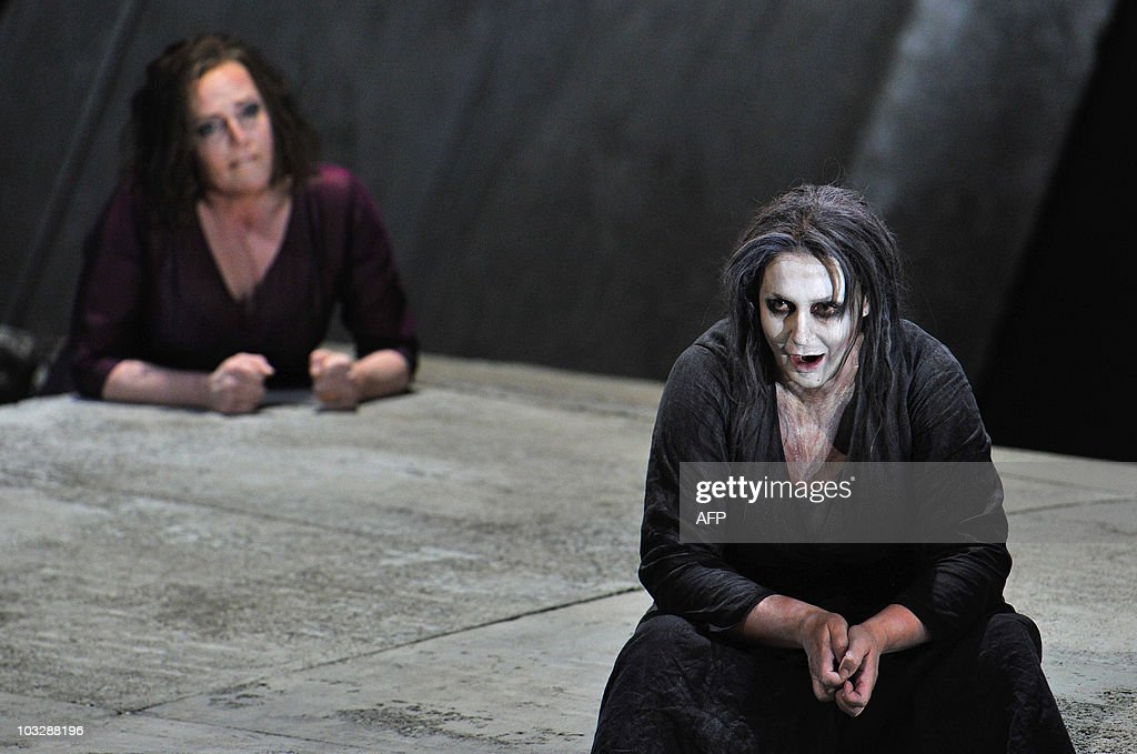Dutch soprano Eva-Maria Westbroek, (L) as Chrysothemis and Swedish soprano Irene Theorin in the role of Elektra perform during a dress rehearsal of the opera 'Elektra' composed by Richard Strauss, on August 4, 2010 in Salzburg. The premiere of the opera will be presented on August 8, 2010 during The Salzburg Festival, the annual high-brow culture fest celebrating this year its 90th anniversary. AFP PHOTO/WILDBILD
