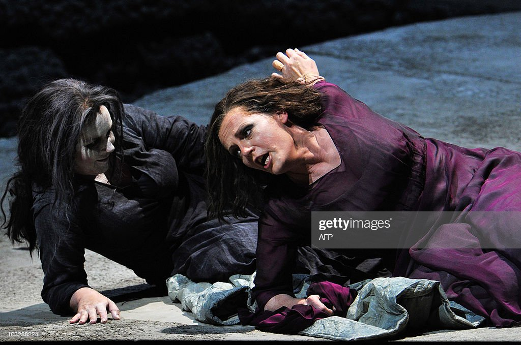 Dutch soprano Eva-Maria Westbroek, (R) as Chrysothemis and Swedish soprano Irene Theorin (L) in the role of Elektra perform during a dress rehearsal of the opera 'Elektra' composed by Richard Strauss, on August 4, 2010 in Salzburg. The premiere of the opera will be presented on August 8, 2010 during The Salzburg Festival, the annual high-brow culture fest celebrating this year its 90th anniversary.