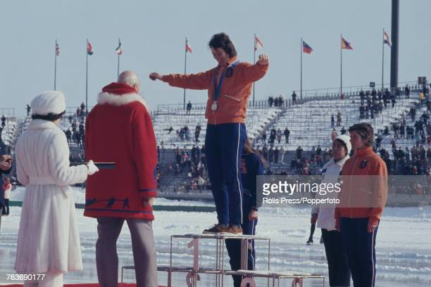 Dutch speed skater Stien Kaiser of the Netherlands pictured raising her arms in the air in celebration on the medal podium after finishing in first...