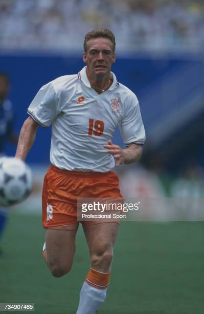 Dutch striker Peter van Vossen makes a run for the ball during play in the 1994 FIFA World Cup quarterfinal match between Netherlands and Brazil at...