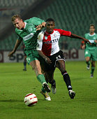 Dutch striker Salomon Kalou of Feyenoord vies with Hungarian Gabor Gyepes of Ferencvaros in Puskas stadium 04 November 2004 in a UEFA CUP...