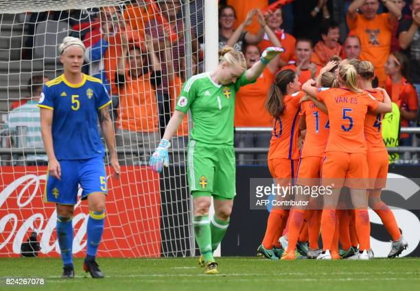 Dutch teammates celebrate scoring the second goal during the UEFA Womens Euro 2017 football match between the Netherlands and Sweden at the De...