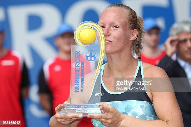 Dutch tennis player Kiki Bertens kisses the trophy after winning the WTA tennis tournament in Nuernberg southern Germany on May 21 2016 Bertens won...