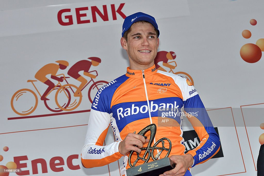 Dutch <a gi-track='captionPersonalityLinkClicked' href=/galleries/search?phrase=Theo+Bos+-+Cyclist&family=editorial&specificpeople=15369892 ng-click='$event.stopPropagation()'>Theo Bos</a> of Rabobank cycling Team celebrates on the podium after winning the third stage of the Eneco Tour cycling race, 188 km from Riemst to Genk, on August 8, 2012. AFP PHOTO/BELGA /DAVID STOCKMAN