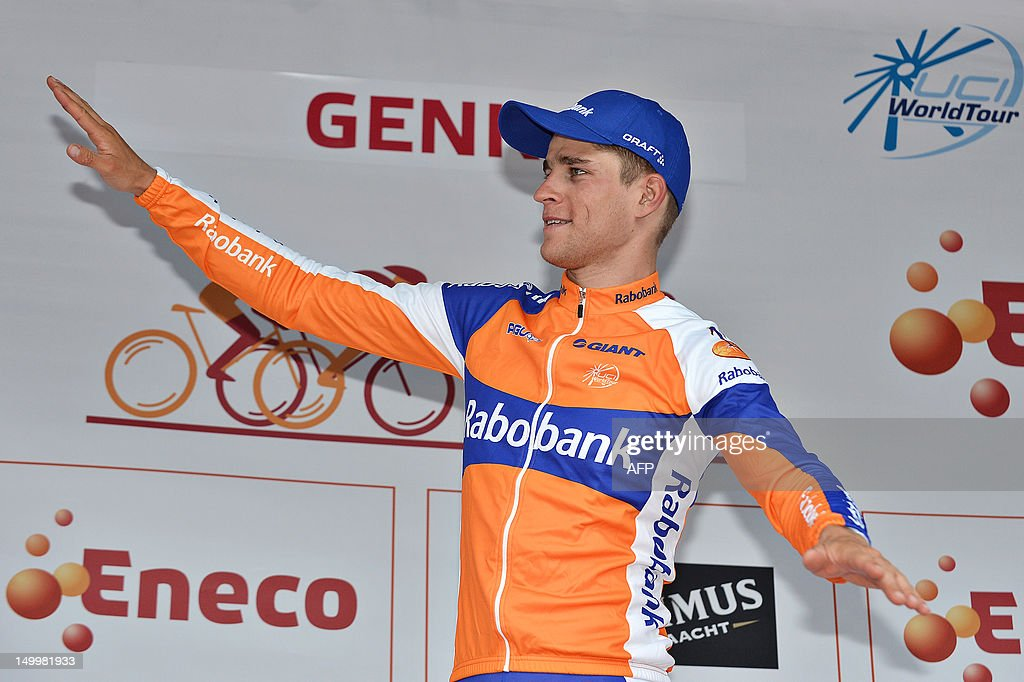 Dutch <a gi-track='captionPersonalityLinkClicked' href=/galleries/search?phrase=Theo+Bos+-+Cyclist&family=editorial&specificpeople=15369892 ng-click='$event.stopPropagation()'>Theo Bos</a> of Rabobank cycling Team celebrates on the podium after winning the third stage of the Eneco Tour cycling race, 188 km from Riemst to Genk, on August 8, 2012. AFP PHOTO/BELGA PHOTO DAVID STOCKMAN