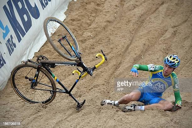 Dutch Thijs Van Amerongen falls during the 2nd stage of the Superprestige cyclocross cycling competition in Zonhoven on November 3 2013 AFP PHOTO /...