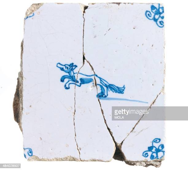 Dutch tile depicting a running dog or fox with spiderhead corners c 1660–1700 from the 1973 excavation at Laurence Pountney Lane City of London