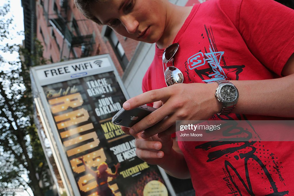 Dutch tourist Bas Derksen surfs the internet while at a free Wi-Fi hotspot on July 11, 2012 in Manhattan, New York City. New York City launched a pilot program Wednesday to provide free public Wi-Fi at public phone booths around the five boroughs. The first ten booths were lit up with Wi-Fi routers attached to the top of existing phone booths, with six booths in Manhattan, two in Brooklyn, and one in Queens. Additional locations, including ones in the Bronx and Staten Island, are to be added soon.