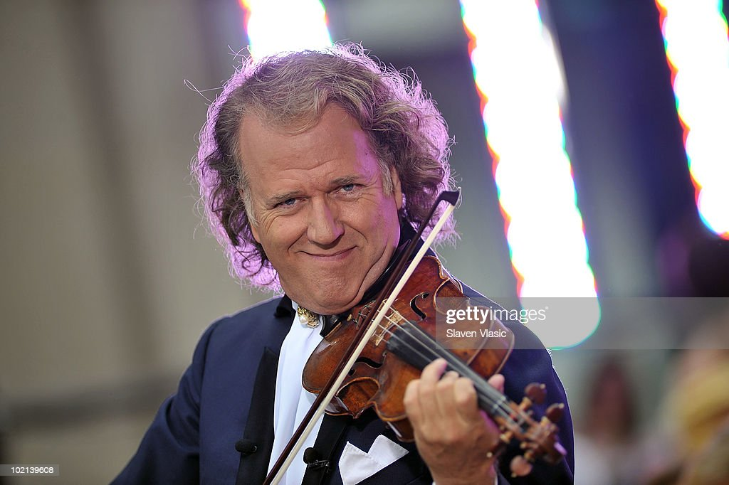 Dutch violinist <a gi-track='captionPersonalityLinkClicked' href=/galleries/search?phrase=Andre+Rieu&family=editorial&specificpeople=1016048 ng-click='$event.stopPropagation()'>Andre Rieu</a> and his Johann Strauss Orchestra perform on NBC's 'Today' at Rockefeller Center on June 16, 2010 in New York City.