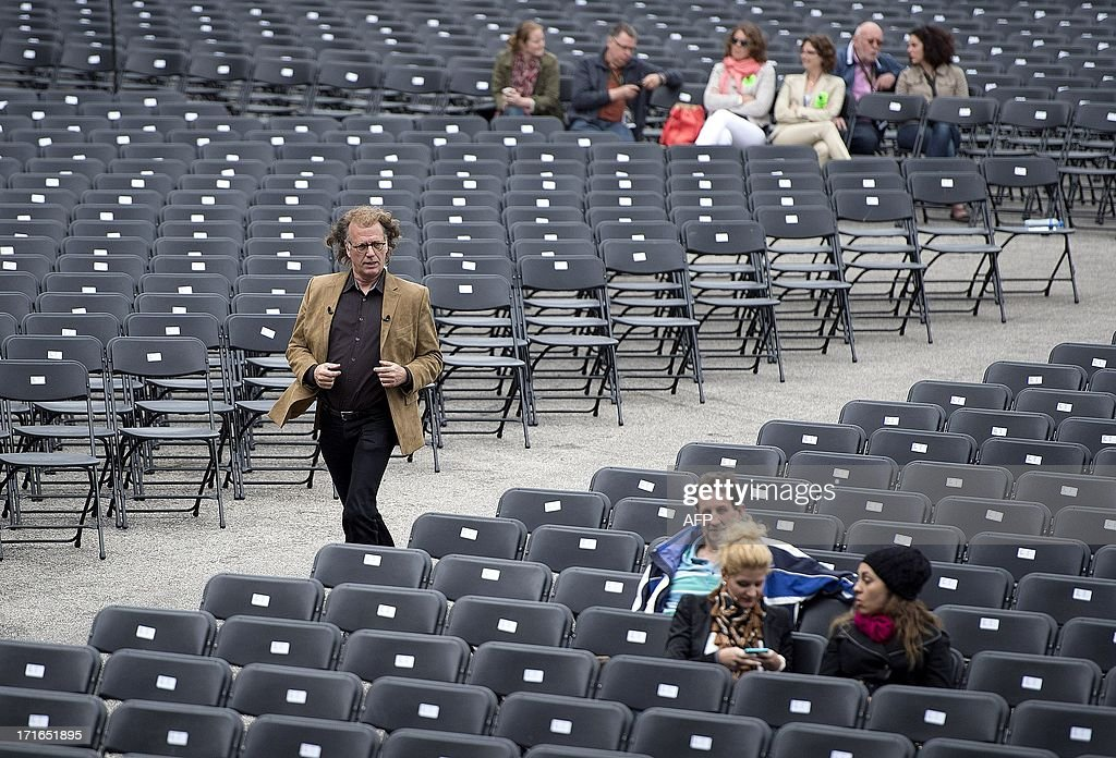 Dutch violonist Andre Rieu runs to the stage during the soundcheck at the Vrijthof square in the centre of Maastricht, on June, 27 2013. Rieu and his orchestra will perform from 28 June until 4 July 8 times in his hometown.