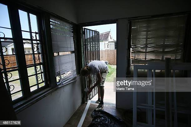 Dutch volunteer with lowernineorg helps rebuild a heavily damaged home in the Lower Ninth Ward on August 24 2015 in New Orleans Louisiana The area...