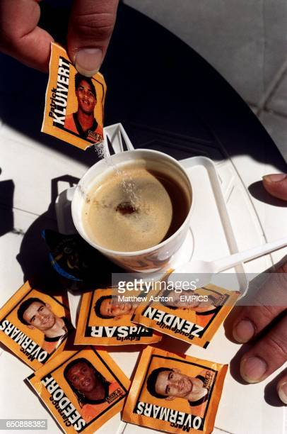 A Dutch waiter makes coffee with Patrick Kluivert sugar in the Dutch training camp in Hoenderloo