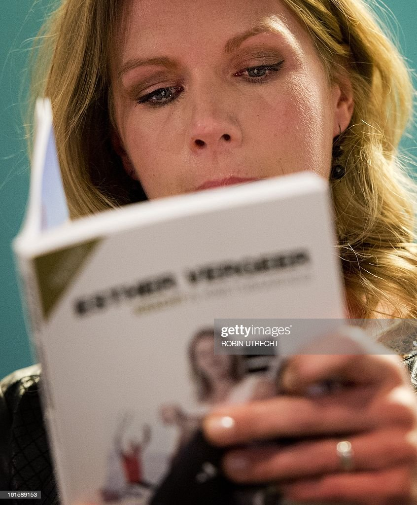Dutch wheelchair tennis star Esther Vergeer looks at her biography 'Kracht en Kwetsbaarheid' ('Strength and Vulnerability' on February 12, 2013 during a press conference at the ABN AMRO World Tennis Tournament in Rotterdam. Vergeer announced at the press conference her retirement after an unbroken run of 470 wins spanning more than 10 years . AFP MPHOTO / ANP / ROBIN UTRECHT - netherlands out -