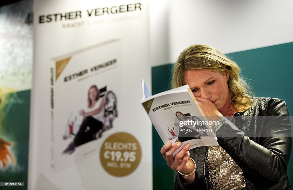 Dutch wheelchair tennis star Esther Vergeer wipes a tear on February 12, 2013 at a press conference at the ABN AMRO World Tennis Tournament in Rotterdam after announcing her retirement after an unbroken run of 470 wins spanning more than 10 years. Vergeer also launched her biography 'Kracht en Kwetsbaarheid' ('Strength and Vulnerability' at the press conference tennis. AFP MPHOTO / ANP / ROBIN UTRECHT - netherlands out -
