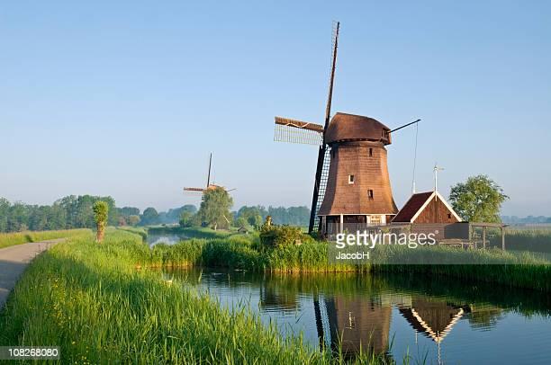 Dutch Windmills Along Canal