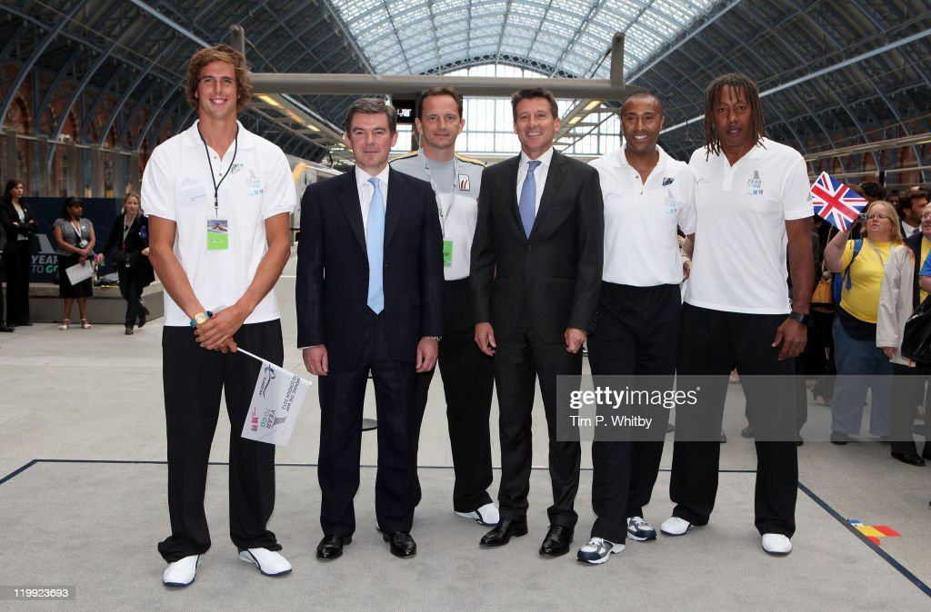 Dutch windsurfer Dorian van Rijsselberghe, UK Minister for Sport and Olympics Hugh Robertson, Belgian Table Tennis Olympian Jean Michel Saive, Chairman of the London Organising Commitee for the Olympic and Paralympic Games Lord Seb Coe, Olympic Athlete Colin Jackson and French Handball Olympian Jackson Richardson and celebrate 'One Year To Go' by getting their footprints cast to mark the first steps on the way to London 2012 in front of Eurostar at St Pancras Station on July 27, 2011 in London, England. Eurostar is the Official International Rail Service Provider for the London 2012 Olympic and Paralympic Games.