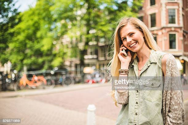Dutch woman in amsterdam on the phone