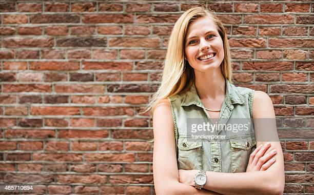 Dutch woman portrait against a brick wall