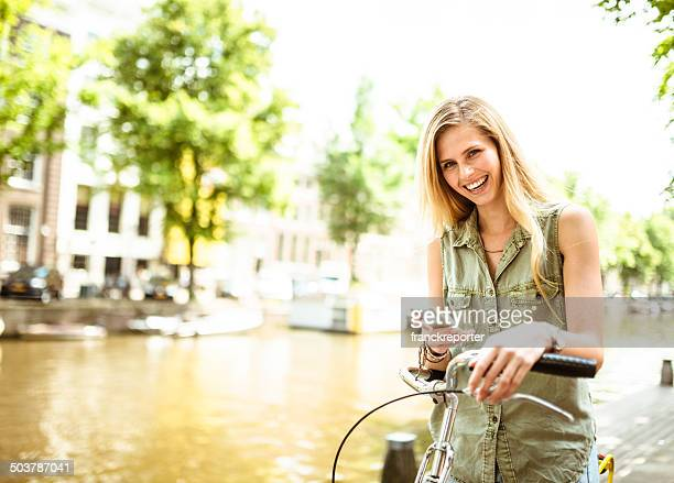 Dutch woman with bicycle in amsterdam text messaging