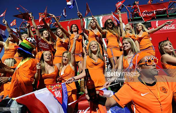 Dutch women in orange miniskirts cheer on their national team in front of the Soccer City Stadium in Johannesburg on June 14 2010 The Dutch Foreign...