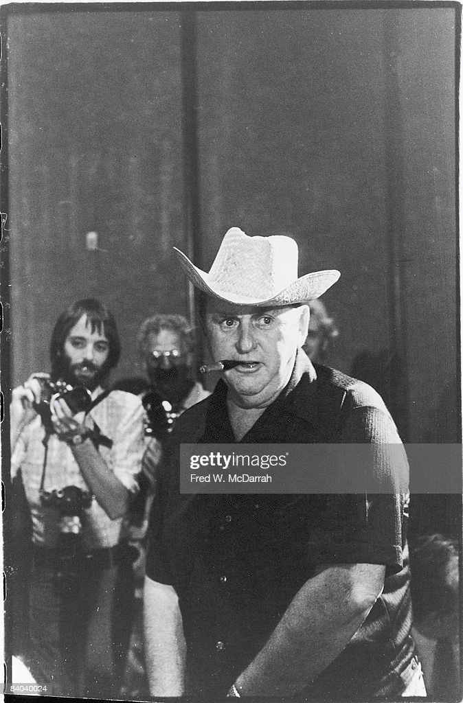 Dutchborn music manager 'Colonel' Tom Parker 1909 1997 born Andreas Cornelis van Kuijk stands to one side of the stage during a press conference to...