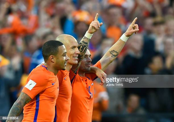 TOPSHOT Dutch's Wesley Sneijder with Dutch's Arjen Robben celebrates after scoring during the FIFA World Cup 2018 qualification football match...