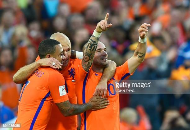 Dutch's Wesley Sneijder with Dutch's Arjen Robben celebrates after scoring during the FIFA World Cup 2018 qualification football match between...