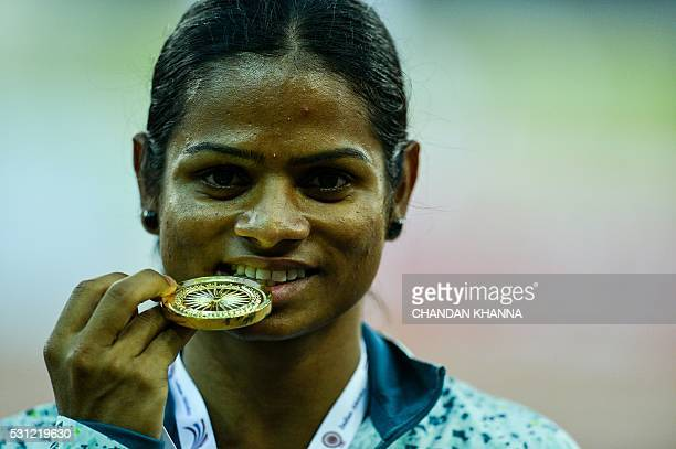 Dutee Chand of Odisha poses with her winning medal after victory in the 100 metre race during 20th Federation Cup National Senior Athletics...